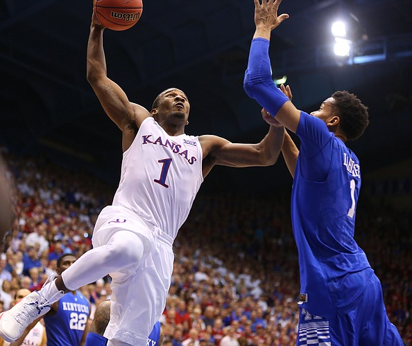 Kansas guard Wayne Selden Jr. (1) gets up to dunk against Kentucky forward Skal Labissiere (1) in overtime, Saturday, Jan. 30, 2016 at Allen Fieldhouse.