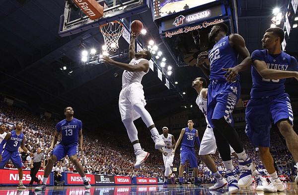 Kansas guard Wayne Selden Jr. (1) gets in for a bucket against Kentucky during the second half, Saturday, Jan. 30, 2016 at Allen Fieldhouse.