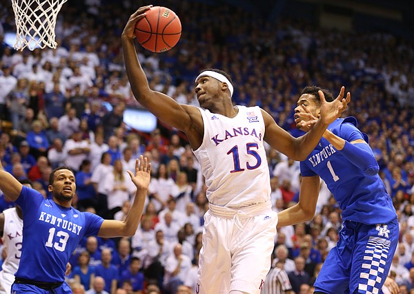 Kansas forward Carlton Bragg Jr. (15) catches a pass down low against Kentucky forward Skal Labissiere (1) during the first half, Saturday, Jan. 30, 2016 at Allen Fieldhouse.