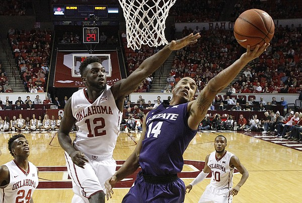 Kansas State guard Justin Edwards (14) shoots in front of Oklahoma forward Khadeem Lattin (12) in the second half of an NCAA college basketball game in Norman, Okla., Saturday, Jan. 9, 2016. Oklahoma won 86-76. (AP Photo/Sue Ogrocki)