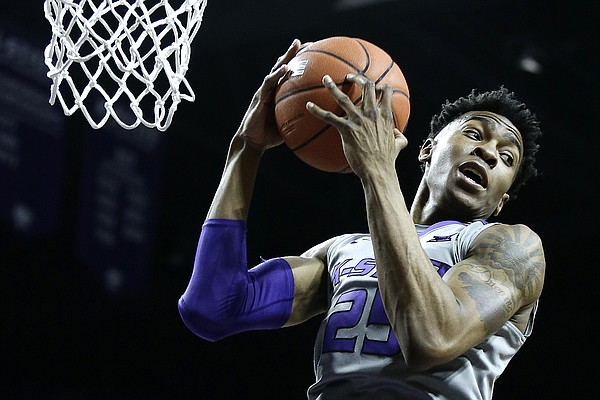 Kansas State's Wesley Iwundu gets a rebound during the first half of an NCAA college basketball game against Iowa State Saturday, Jan. 16, 2016, in Manhattan, Kan. (AP Photo/Charlie Riedel)