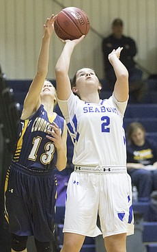 Seabury's Celia Taylor-Puckett (2) gets off a shot after getting past Council Grove's Beau Peterson (13) during their game Tuesday evening at Bishop Seabury.