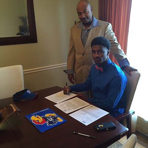 "New KU cornerback Kyle ""Money"" Mayberry signing his letter of intent Wednesday morning."