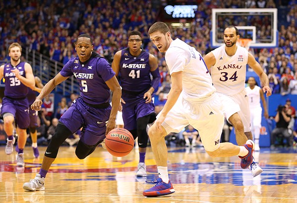 Kansas guard Sviatoslav Mykhailiuk comes away with a steal from Kansas State guard Barry Brown (5) during the second half on Wednesday, Feb. 3, 2016 at Allen Fieldhouse.