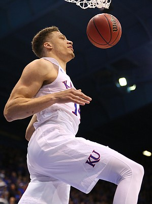 Kansas guard Brannen Greene (14) comes down from a breakaway dunk with seconds remaining in the the Jayhawks' 77-59 win over Kansas State, Wednesday, Feb. 3, 2016 at Allen Fieldhouse. Kansas head coach Bill Self later apologized for Kansas State for the play.