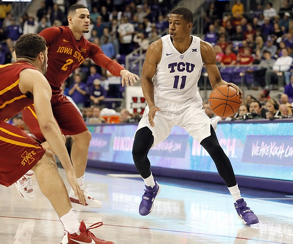 Iowa State's Georges Niang, left, and Abdel Nader (2) defend as TCU guard Brandon Parrish (11) looks for an opportunity to the basket during an NCAA college basketball game, Saturday, Jan. 23, 2016, in Fort Worth, Texas. Iowa State won 73-60. (AP Photo/Tony Gutierrez)