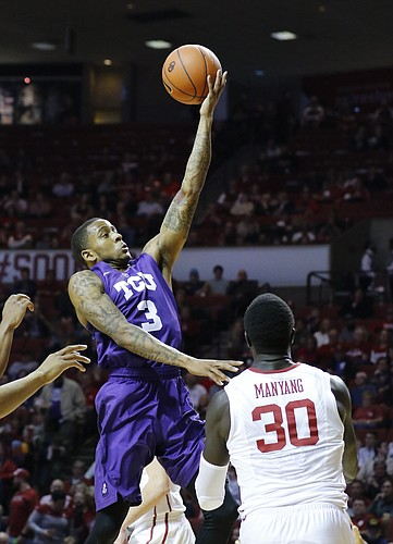 TCU guard Malique Trent (3) goes to the basket over Oklahoma center Akolda Manyang (30) during the first half of an NCAA college basketball game in Norman, Okla., Tuesday, Feb. 2, 2016. (AP Photo/Alonzo Adams)