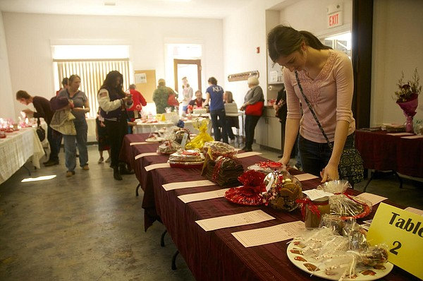 Emma Bailey looks over some of the sweets and art available for bid at the Baldwin City chocolate auction in February 2015.