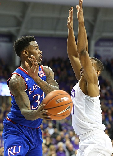 Kansas forward Jamari Traylor (31) dishes a pass around TCU guard Brandon Parrish during the first half, Saturday, Feb. 6, 2016 at Schollmaier Arena in Forth Worth, Texas.