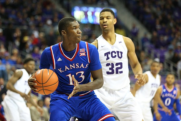 Kansas forward Cheick Diallo (13) looks to pass as he is defended by TCU forward Karviar Shepherd (32) during the second half, Saturday, Feb. 6, 2016 at Schollmaier Arena in Forth Worth, Texas.