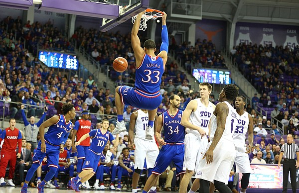 Kansas forward Landen Lucas (33) delivers on a lob jam against TCU during the second half, Saturday, Feb. 6, 2016 at Schollmaier Arena in Forth Worth, Texas.