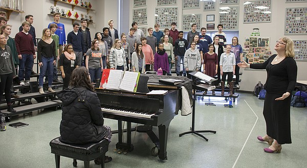 Free State High School choir director Hilary Morton leads students in the Chamber Choir through rehearsals Monday at the high school. The choir will perform at a public concert at 7 p.m. Thursday at Liberty Memorial Central Middle School along with the Lawrence High School A Cappella Choir.