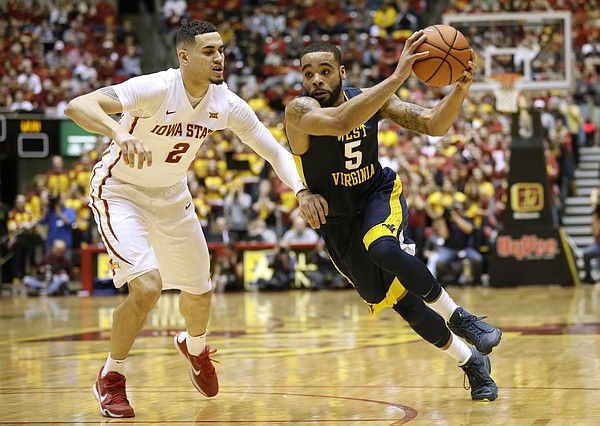 West Virginia guard Jaysean Paige drives past Iowa State forward Abdel Nader, left, during the first half of an NCAA college basketball game, Tuesday, Feb. 2, 2016, in Ames, Iowa. (AP Photo/Charlie Neibergall)