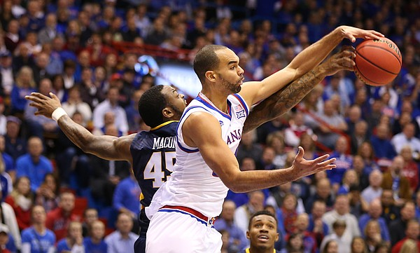 Kansas forward Perry Ellis wrestles with West Virginia forward Elijah Macon (45) for a ball during the first half, Tuesday, Jan. 9, 2016 at Allen Fieldhouse.