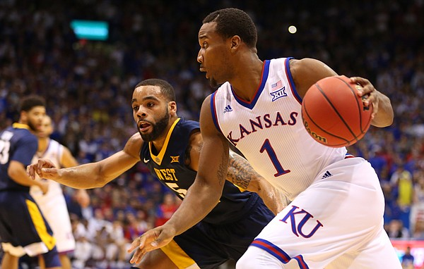 Kansas guard Wayne Selden Jr. (1) drives against West Virginia guard Jaysean Paige (5) during the first half, Tuesday, Jan. 9, 2016 at Allen Fieldhouse.