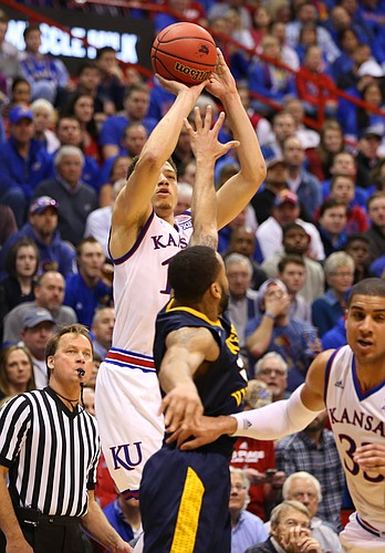 Kansas guard Brannen Greene (14) puts a three over West Virginia guard Jaysean Paige (5) from the wing during the second half, Tuesday, Jan. 9, 2016 at Allen Fieldhouse.