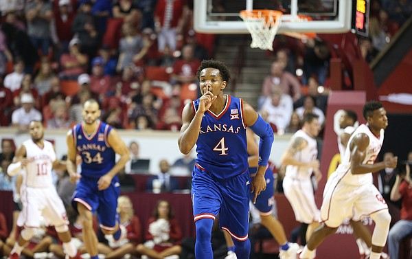 Kansas guard Devonte' Graham (4) shushes the crowd after hitting a three during the first half, Saturday, Feb. 13, 2016 at Lloyd Noble Center in Norman, Okla.