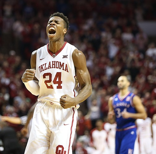 Oklahoma guard Buddy Hield (24) roars after hitting a three against the Jayhawks during the second half, Saturday, Feb. 13, 2016 at Lloyd Noble Center in Norman, Okla.