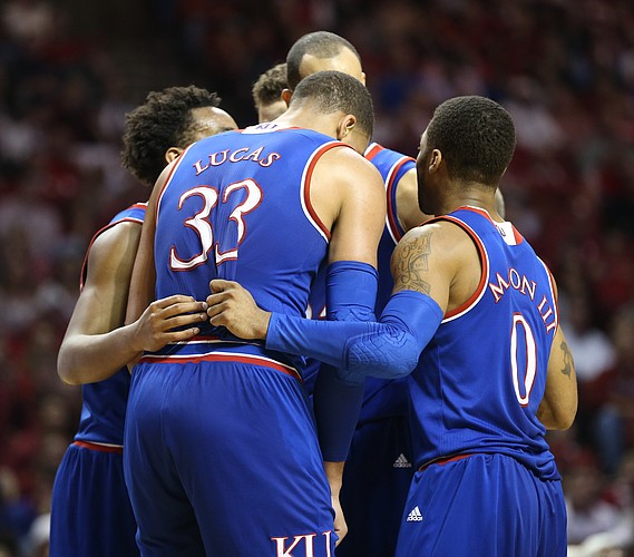 The Jayhawks huddle up during the second half, Saturday, Feb. 13, 2016 at Lloyd Noble Center in Norman, Okla.