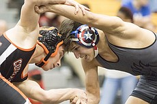 Free State sophomore Bennett King, right, goes head-to-head against Shawnee Mission Northwest freshman Charles Brockmann in the 113 pound division at the Sunflower League Tournament Saturday in Overland Park.