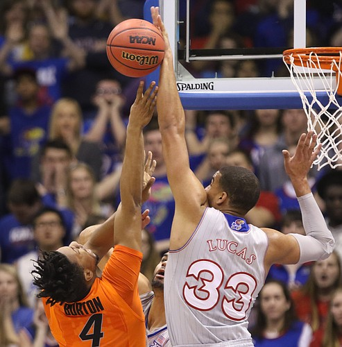 Kansas forward Landen Lucas (33) blocks a shot by Oklahoma State guard Joe Burton (4) during the first half, Monday, Feb. 15, 2016 at Allen Fieldhouse.