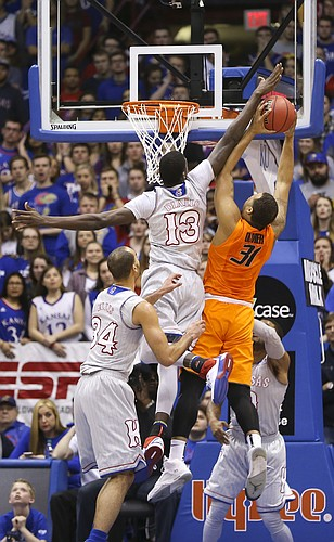 Kansas forward Cheick Diallo (13) blocks a shot by Oklahoma State forward Chris Olivier (31) during the first half, Monday, Feb. 15, 2016 at Allen Fieldhouse.