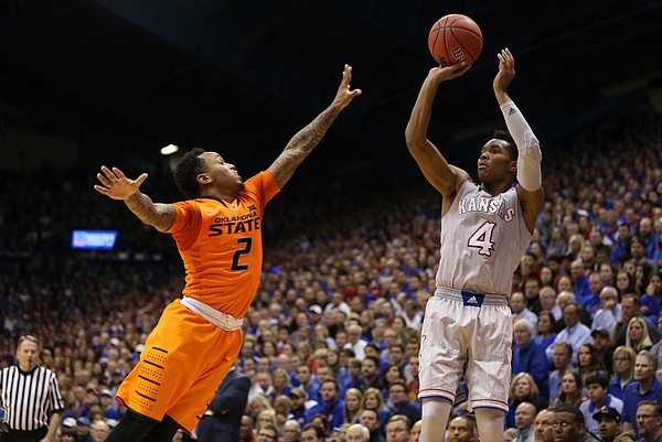 Kansas guard Devonte' Graham (4) pulls up for a three against Oklahoma State guard Tyree Griffin (2) during the second half, Monday, Feb. 15, 2016 at Allen Fieldhouse.