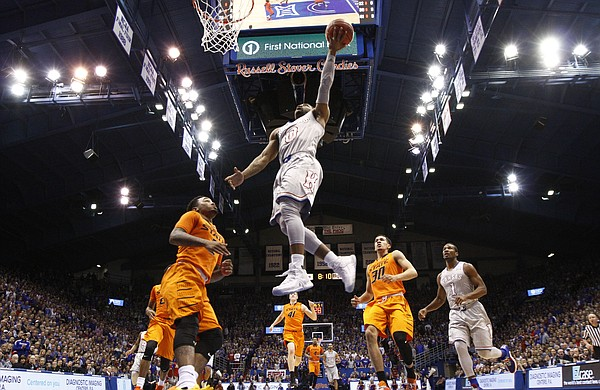 Kansas guard Frank Mason III (0) soars in for a bucket against Oklahoma State during the first half, Monday, Feb. 15, 2016 at Allen Fieldhouse.