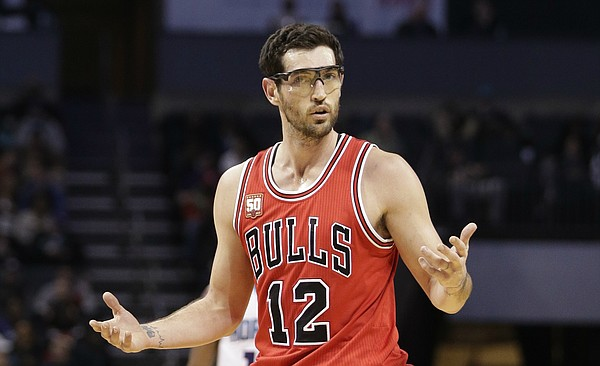 Chicago Bulls' Kirk Hinrich (12) reacts to being called for a foul against the Charlotte Hornets in the second half of an NBA basketball game in Charlotte, N.C., Monday, Feb. 8, 2016. The Hornets won 108-91. (AP Photo/Chuck Burton)