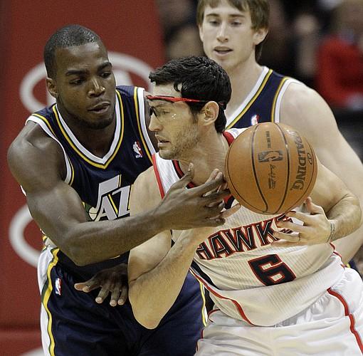 Atlanta Hawks guard Kirk Hinrich (6) and Utah Jazz power forward Paul Millsap (24) play during an NBA basketball game Sunday, March 25, 2012, in Atlanta. (AP Photo/David Goldman)
