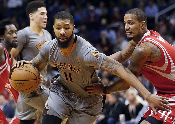 Phoenix Suns forward Markieff Morris (11) drives past Houston Rockets forward Trevor Ariza during the fourth quarter of an NBA basketball game Thursday, Feb. 4, 2016, in Phoenix. The Rockets defeated the Suns 111-105. (AP Photo/Rick Scuteri)