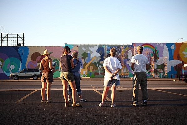 Members of the Joplin, Mo. design team congregate in front of the then-unfinished mural in this photo from summer 2011.
