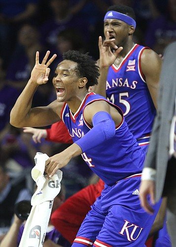 Kansas guard Devonte' Graham (4) and forward Carlton Bragg Jr. react to a big three from Kansas guard Sviatoslav Mykhailiuk (10) during the first half, Saturday, Feb. 20, 2016 at Bramlage Coliseum in Manhattan, Kan.