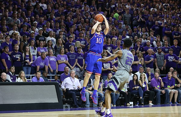Kansas guard Sviatoslav Mykhailiuk (10) puts up a three before Kansas State forward Wesley Iwundu (25) during the first half, Saturday, Feb. 20, 2016 at Bramlage Coliseum in Manhattan, Kan.
