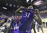Kansas forward Jamari Traylor (31) pops his jersey before the Kansas State fans following the Jayhawks' 72-63 win over the Wildcats, Saturday, Feb. 20, 2016 at Bramlage Coliseum in Manhattan, Kan.