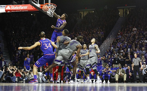 Kansas forward Jamari Traylor (31) hammers home a dunk against Kansas State during the second half, Saturday, Feb. 20, 2016 at Bramlage Coliseum in Manhattan, Kan.