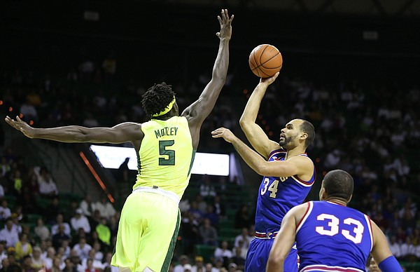 Baylor forward Johnathan Motley (5) extends to defend against a shot from Kansas forward Perry Ellis (34) during the first half, Tuesday, Feb. 23, 2016 at Ferrell Center in Waco, Texas.