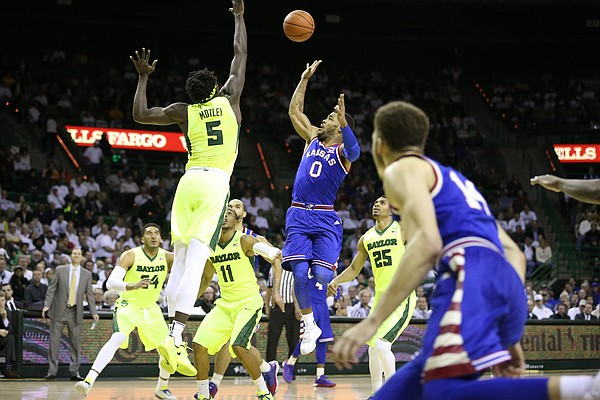 Kansas guard Frank Mason III (0) puts a floater over Baylor forward Johnathan Motley (5) during the first half, Tuesday, Feb. 23, 2016 at Ferrell Center in Waco, Texas.