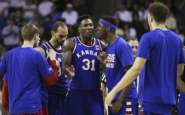 Kansas forward Jamari Traylor (31) gets an earful of praise from Kansas forward Carlton Bragg Jr. during a timeout in the second half, Tuesday, Feb. 23, 2016 at Ferrell Center in Waco, Texas.
