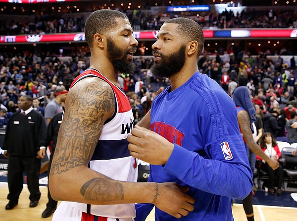 Washington Wizards forward Markieff Morris, left, and Detroit Pistons forward Marcus Morris talk on the court after an NBA basketball game Friday, Feb. 19, 2016, in Washington. The Wizards won 98-86. (AP Photo/Alex Brandon)