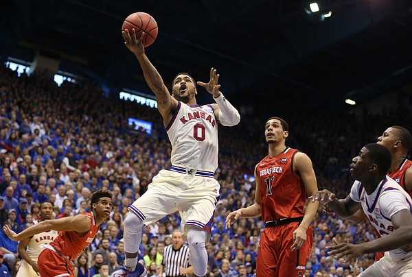 Kansas guard Frank Mason III (0) floats in for a bucket past Texas Tech forward Zach Smith (11) during the second half, Saturday, Feb. 27, 2016 at Allen Fieldhouse.