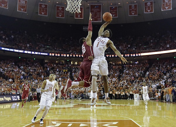 Texas guard Isaiah Taylor (1) drives to the basket against Oklahoma guard Jordan Woodard (10) during the second half of an NCAA college basketball game, Saturday, Feb. 27, 2016, in Austin, Texas. Texas won 76-63. (AP Photo/Eric Gay)