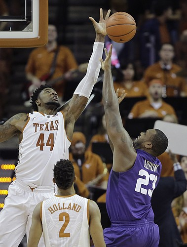 TCU forward Devonta Abron (23) is blocked by Texas center Prince Ibeh (44) as he drives to the basket during the second half of an NCAA college basketball game, Tuesday, Jan. 26, 2016, in Austin, Texas. Texas won 71-54. (AP Photo/Eric Gay)