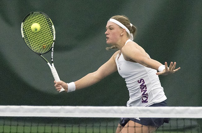 Kansas freshman Nina Khmelnitckaia reaches for a volley during her number one doubles match against New Mexico Sunday afternoon at the Jayhawk Tennis Center.