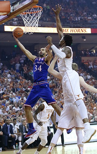 Kansas forward Perry Ellis drives to the basket for two of his 15 first-half points against Texas in a game Monday, Feb. 29, 2016 at the Frank Erwin Center in Austin, Texas.