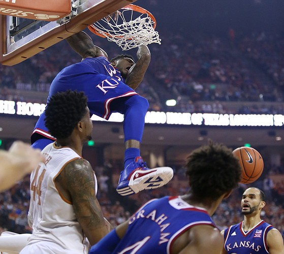 Kansas forward Jamari Traylor (31) swings on the rim after a dunk in the 2nd-half of the Jayhawks 86-56 win over the Longhorns Monday, Feb. 29, 2016 at the Frank Erwin Center in Austin, Texas.