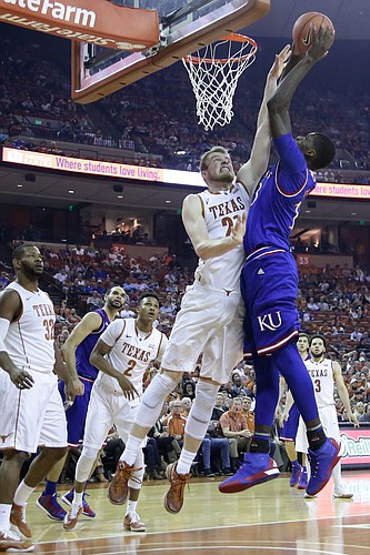 Kansas forward Cheick Diallo (13) goes up hard against Texas forward Connor Lammert (21) and draws a foul in a Jayhawks win over the Longhorns Monday, Feb. 29, 2016 at the Frank Erwin Center in Austin, Texas.