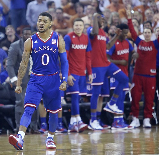 Kansas guard Frank Mason III (0) celebrates a basket with the KU bench in the background in a game against the Longhorns Monday, Feb. 29, 2016 at the Frank Erwin Center in Austin, Texas. .
