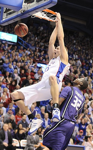 (FILE) Kansas center Cole Aldrich delivers a thunderous dunk over Kansas State forward Jamar Samuels during the first half Tuesday, Jan. 13, 2009 at Allen Fieldhouse.