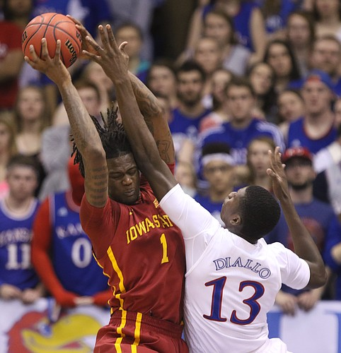 Kansas forward Cheick Diallo (13) fights for a rebound with Iowa State forward Jameel McKay (1) during the first half on Saturday, March 5, 2016 at Allen Fieldhouse.
